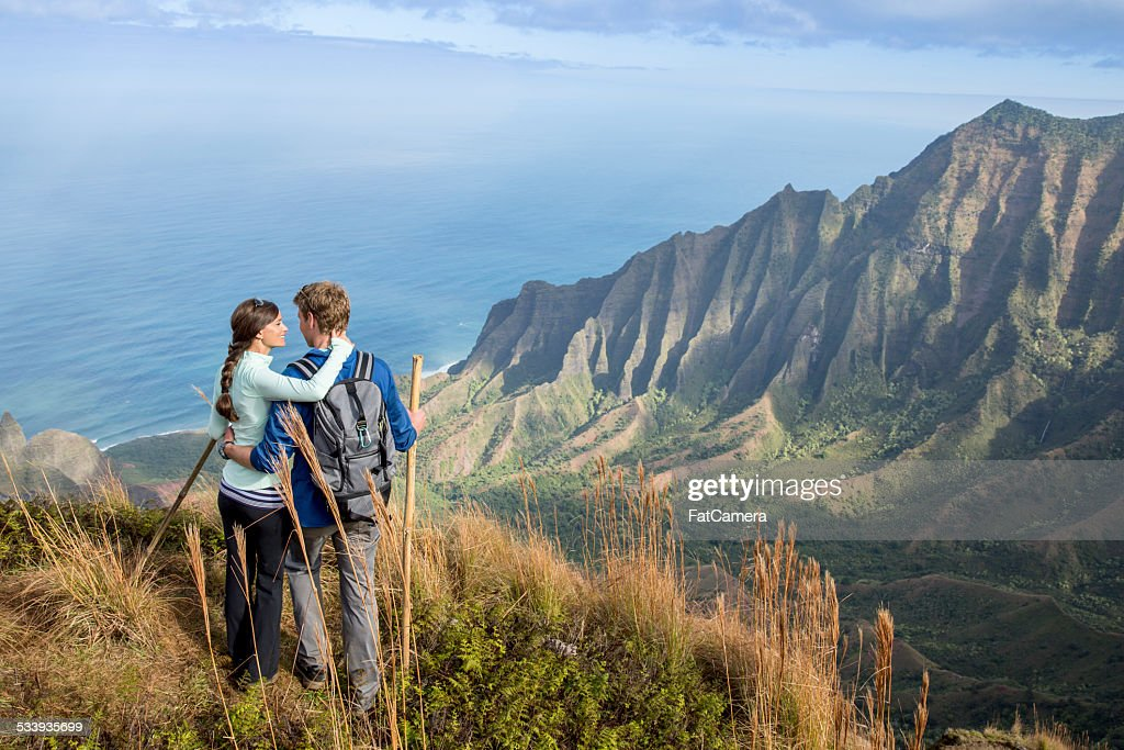 Couple hiking while on vacation in Hawaii : Stock Photo