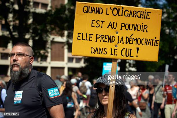 A couple hold a placard reading 'When Oligarchy comes to power it takes democracy in the ass' A quotmaree populairequot demonstration was called by...