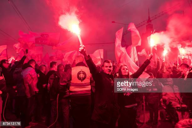 Couple hold flares as as thousands gather for the annual nationalist march of Poland´s Independency Day Poland's Independence Day is a annual day to...
