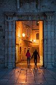 couple hold hands walk through doorway