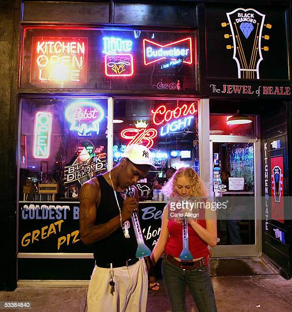 A couple hold hands on Beale Street August 13 2005 in Memphis Tennessee Beale St is the entertainment hub of Memphis