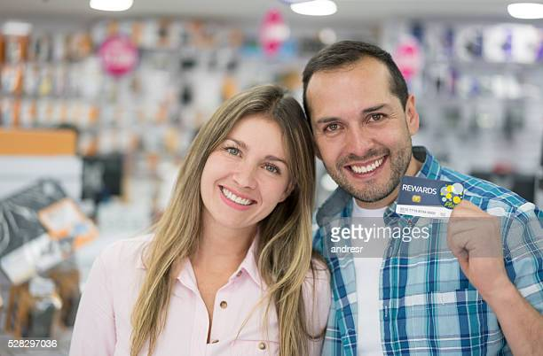 Couple holding a loyalty card