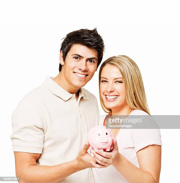 Couple Holding a Piggy Bank - Isolated
