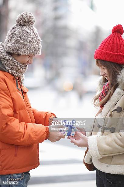 Couple holding a present