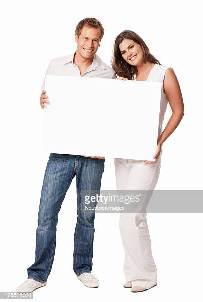 couple holding a white blank sign - isolated - blank sign stock photos and pictures