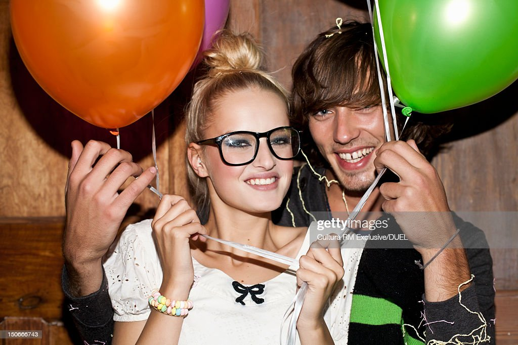 Couple holding balloons together : Stock Photo