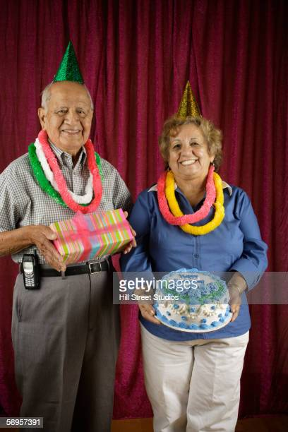 Funny birthday images free stock photos and pictures getty images couple holding birthday cake and present voltagebd Gallery