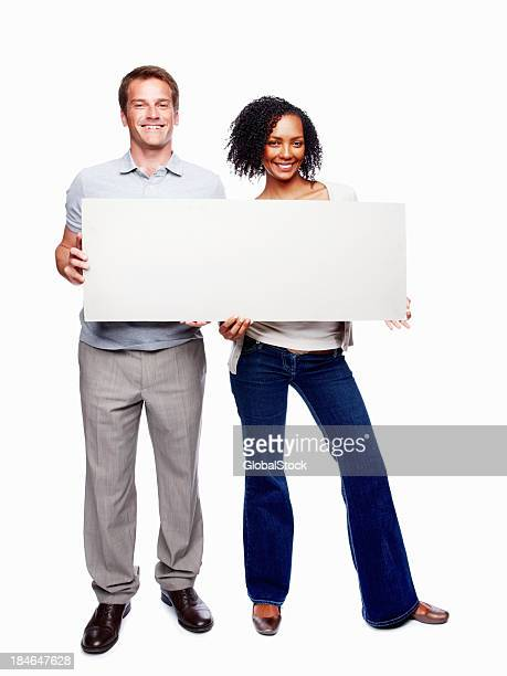 Couple holding blank placard