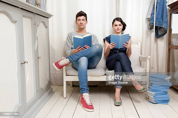 Couple holding books