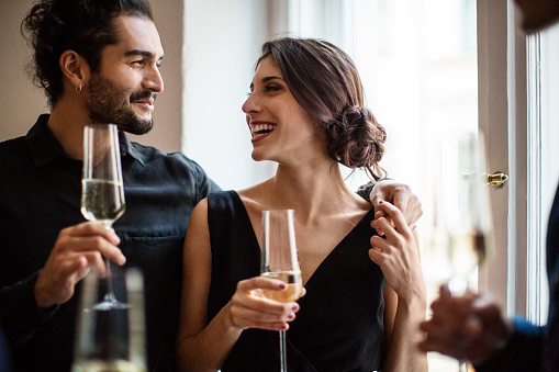 Couple holding champagne flutes - gettyimageskorea