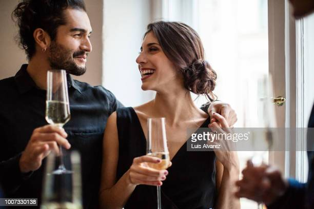 couple holding champagne flutes - elegance stock pictures, royalty-free photos & images