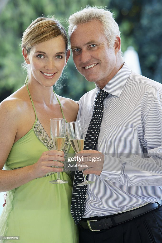 Couple Holding Champagne Flutes : Stock Photo