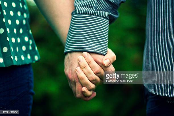 couple holding hand - catherine macbride stock-fotos und bilder
