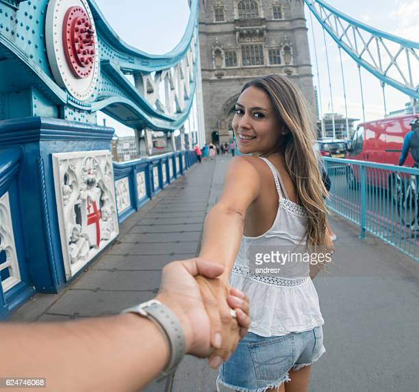 Couple holding hands and traveling together