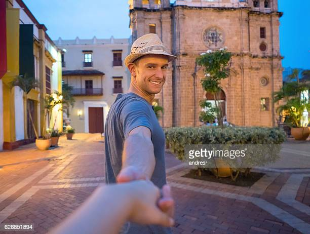 couple holding hands and traveling together - following stock pictures, royalty-free photos & images
