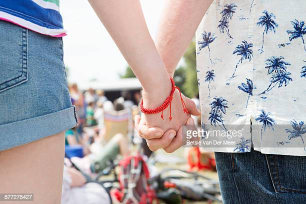 Couple holding hands at festival