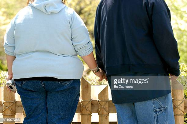 Couple Holding Hands at the Bronx Zoo