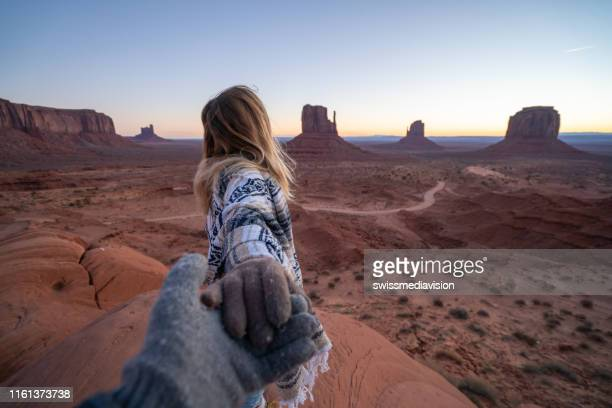 couple holding hands in american desert; boyfriend's point of view ; people travel usa - following stock pictures, royalty-free photos & images