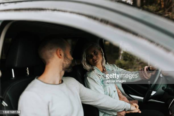 couple holding hands in car - västra götaland county stock pictures, royalty-free photos & images