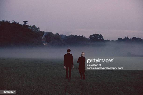 couple holding hands in field - archival stock pictures, royalty-free photos & images