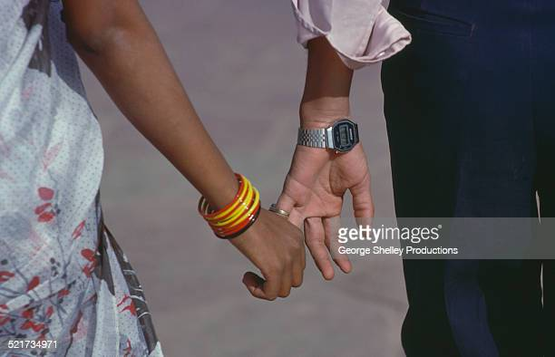 Couple holding hands in India