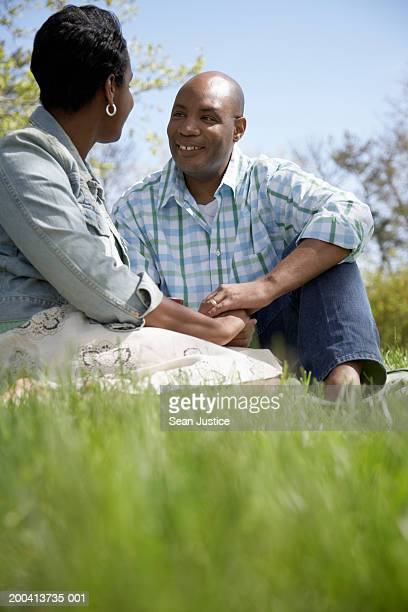 couple holding hands in park, side view, close-up - older women in short skirts stock pictures, royalty-free photos & images