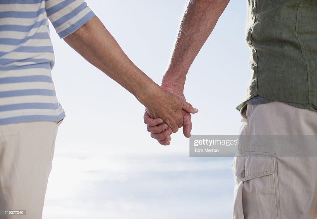 Couple holding hands on beach : Stock Photo