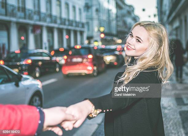 Couple Holding hands on the street