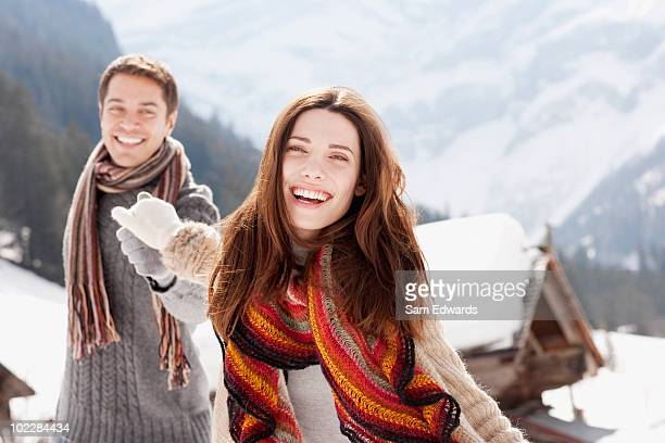 Couple holding hands outdoors in snow