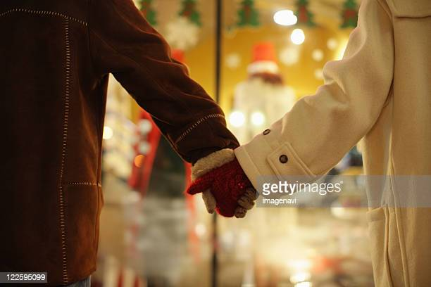 couple holding hands - mitten stock pictures, royalty-free photos & images