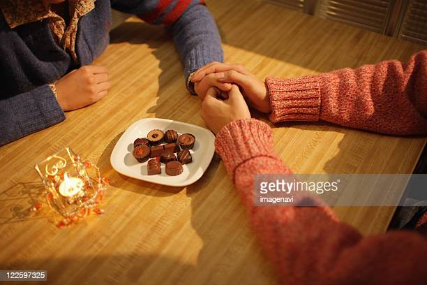 couple holding hands - couple chocolate stock pictures, royalty-free photos & images