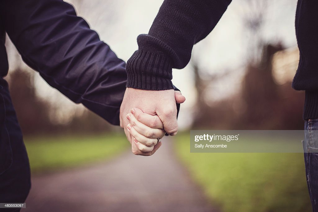 Couple holding hands : Stock Photo