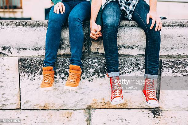 couple holding hands - human leg stock pictures, royalty-free photos & images