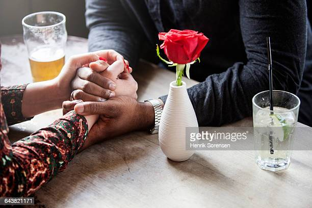 a couple holding hands - black rose stock pictures, royalty-free photos & images