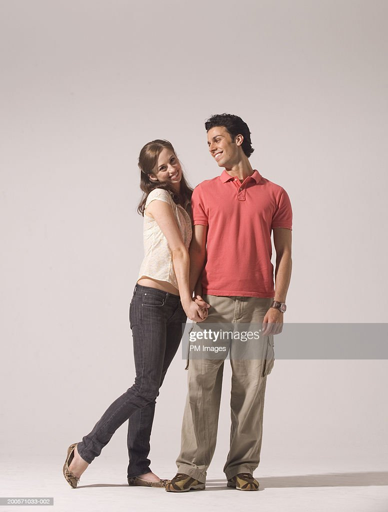 Couple holding hands, smiling : Stock Photo