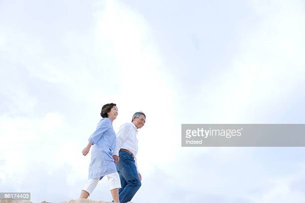 Couple holding hands, taking a walk