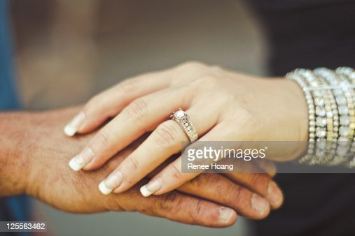 Couple Holding Hands With Engagement Ring Stock Photo ...