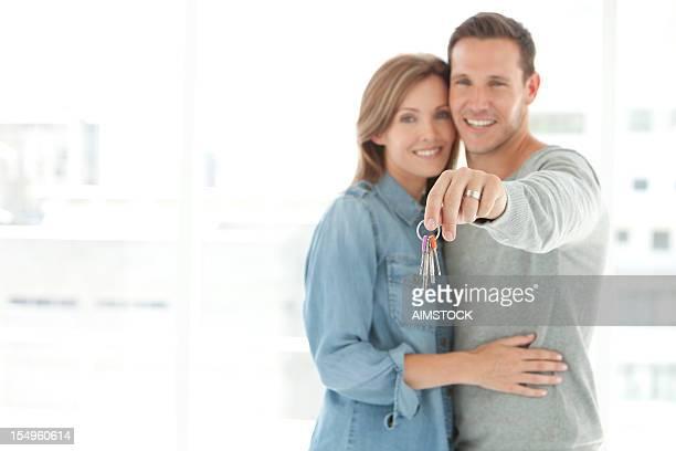 Couple holding home keys