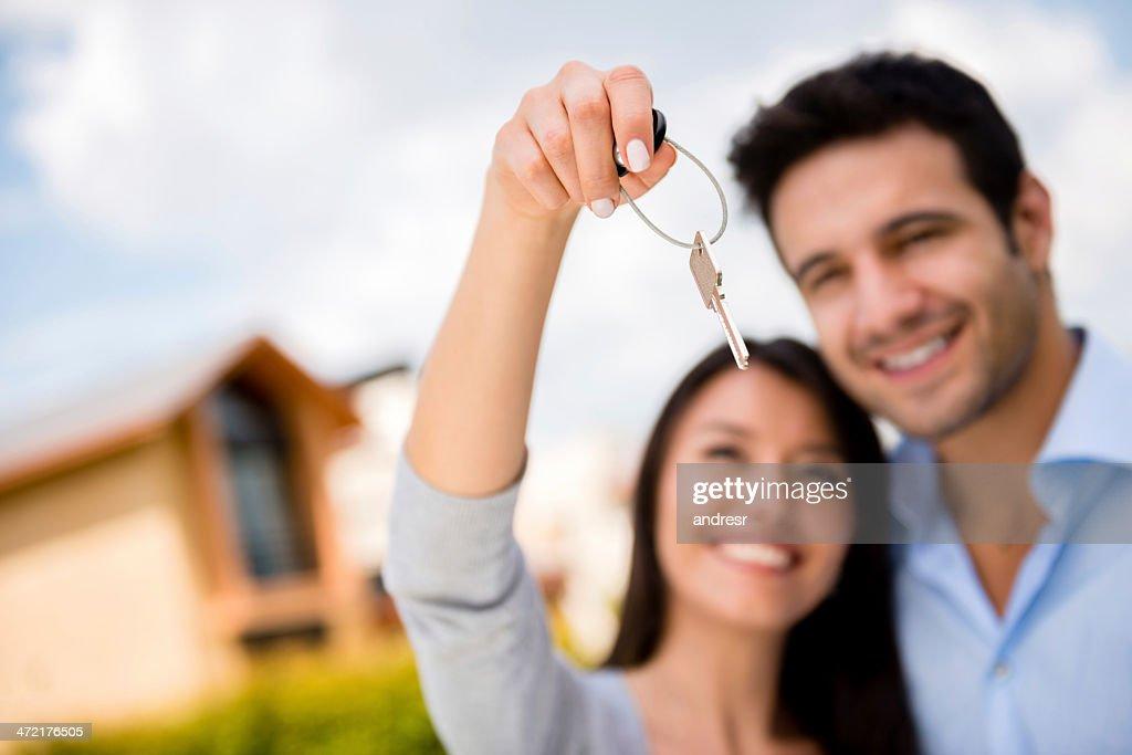 Couple holding house keys : Stock Photo