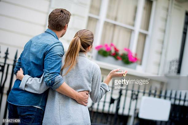 couple holding house keys - house key stock photos and pictures