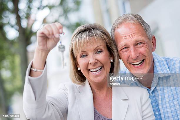 Couple holding key house
