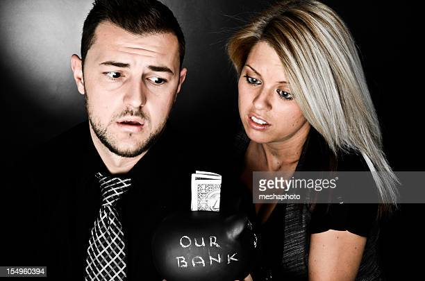 Couple Holding Piggy Bank Savings Concept