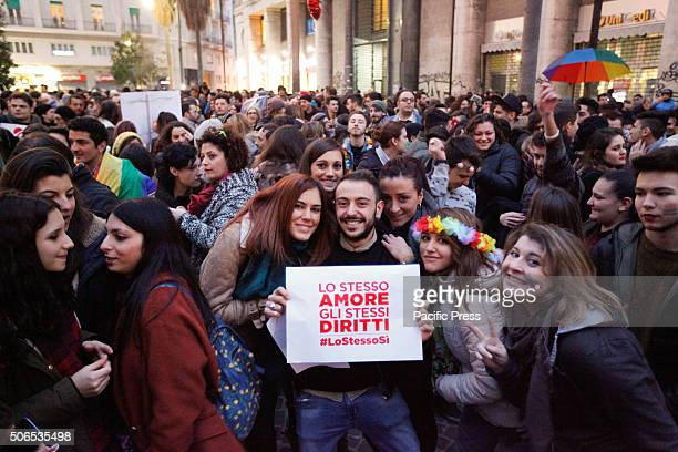 Couple holding placard during demonstration in Naples People demonstrate for the right of samesex couples to marriage The event was organized by ARCI...