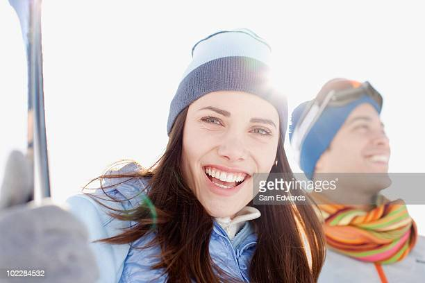 Couple holding skis