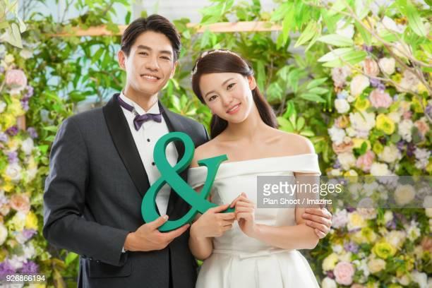 Couple holding & symbol