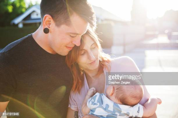 A couple holding their newborn baby
