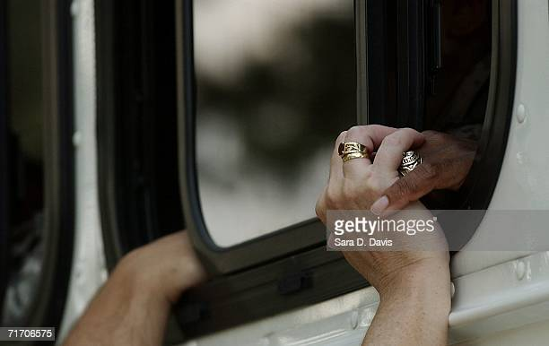 A couple holds hands through a bus window before soldiers with the 82nd Airborne Division deploy to Iraq August 23 2006 in Fort Bragg North Carolina...