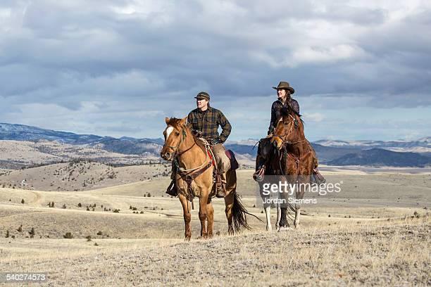 A couple horse back riding.