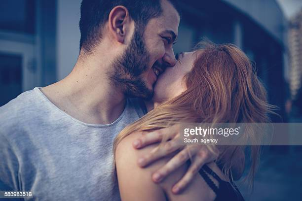 couple hug and kiss - heterosexual couple photos stock photos and pictures