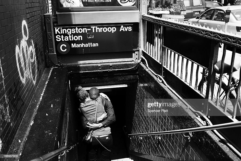 A couple hug on the stairs at the Kingston-Throop Ave. station where MTA worker Harry Kaufman was killed on November 26, 1995, after being attacked with gasoline and fire in a botched robbery at the token booth in Bedford-Stuyvesant on May 16, 2013 in Brooklyn borough of New York City. While two teenagers were charged in the case, the defense had accused New York Police Detective Louis Scarcella of beating one of the suspects. Following the recent clearing of David Ranta of murder after serving a 23-year prison sentence, the Brooklyn, N.Y. District Attorney is reviewing 50 murder cases investigated by celebrated Detective Louis Scarcella. The review of cases will give special scrutiny to those cases which appear weakest. Scarcella, 61 and now retired, denies ever having used unethical tactics to secure a conviction.